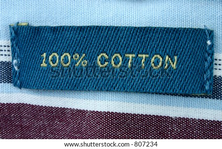 100% cotton - real macro of clothing label - stock photo