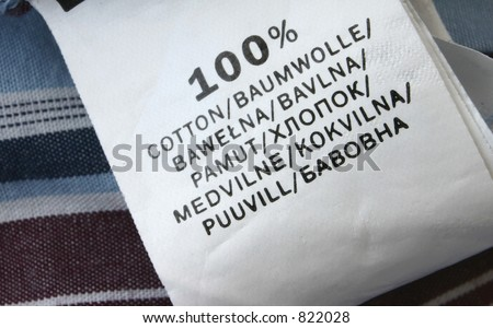 100% cotton - real macro of clothing label #4 - stock photo