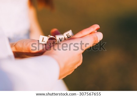 couple, love inscription lined with cubes - stock photo