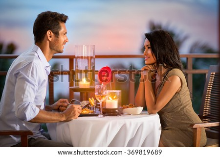 Couple sharing romantic sunset dinner on tropical resort  - stock photo