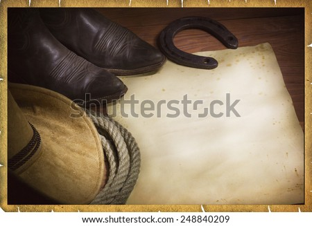 cowboy background with western hat and lasso and paper for text - stock photo