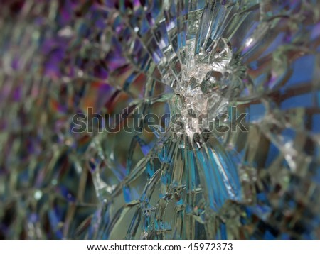 cracked bulletproof glass on an old army Humvee. with extremely polarized cracks and shallow depth of field - stock photo