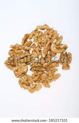 cracked walnut isolated on the white background  - stock photo
