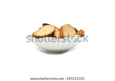 Crackers of bread in a plate on a white background. Photo.