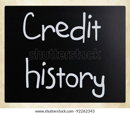 """Credit history"" handwritten with white chalk on a blackboard - stock photo"