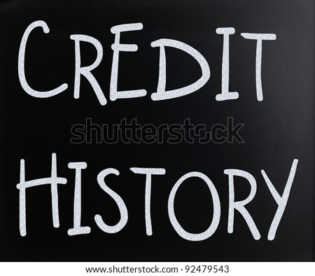 """Credit history"" handwritten with white chalk on a blackboard - stock photo"