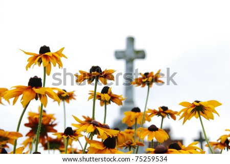 Cross on a old christian cemetery somwhere in Poland. - stock photo