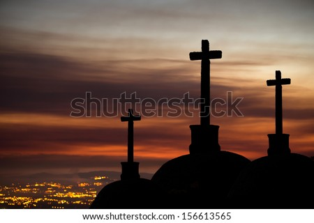 3 Crosses in a Cloudy Sunset with Smoke from the Fire - stock photo