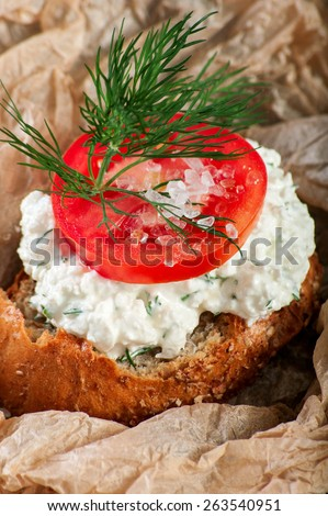 crouton with curd and tomato - stock photo