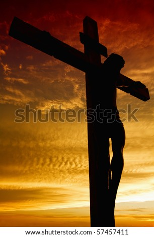 Crucifixion of Jesus Christ during sunset - stock photo