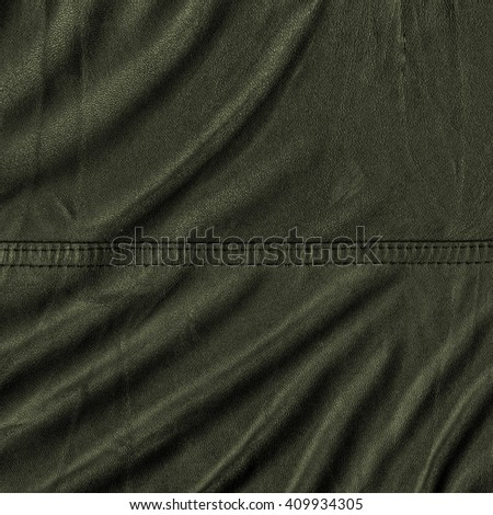 crumpled  green leather surface