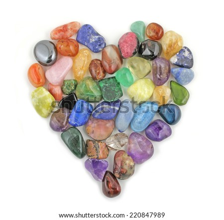 Crystal Heart  -  A Love Heart formed from tumbled precious healing stones on a white background  - stock photo