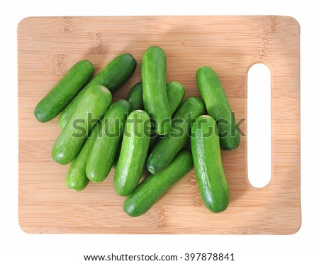 cucumbers  on cutting board isolated on white