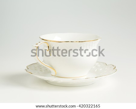 cup and saucer on a white background range, tableware - stock photo