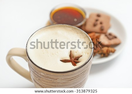 Cup of cappuccino decorated with star anise