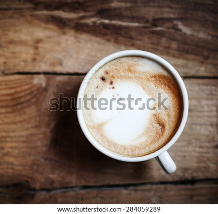Cup of Coffee  for breakfast on rustic wooden table, top view. Cappuccino over wooden background with copy space for text  - stock photo