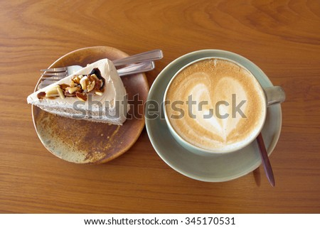 cup of coffee latte and delicious  coffee cake - stock photo