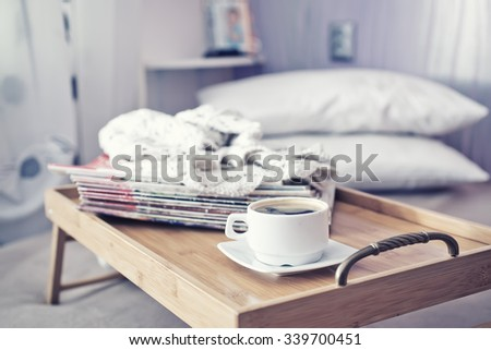 cup of coffee on retro vintage wooden tray