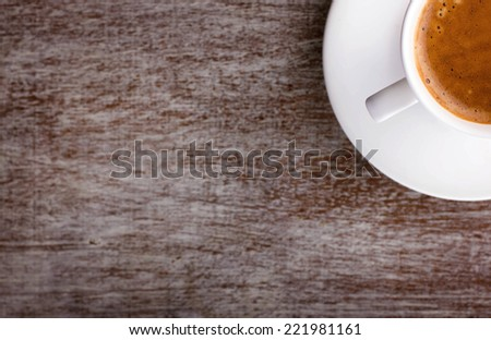 cup of coffee with foam on saucer with place for your text, top view - stock photo