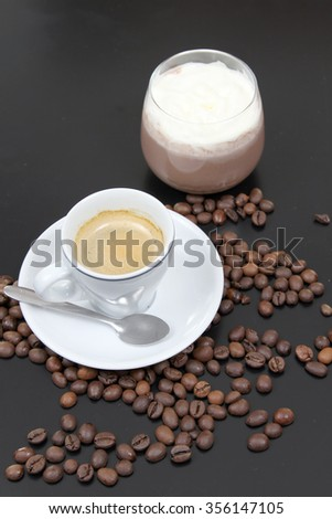Cup of tasty coffee and cup of chocolate - stock photo