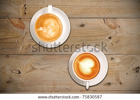 2 cups of coffee with latte art - stock photo