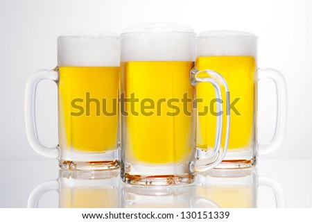 3 cups of draft beer stein - stock photo
