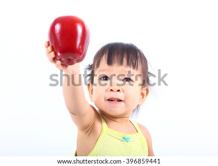 Cute baby with red apple (eating healthy food)