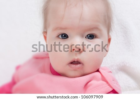 Cute beautiful little girl looking at camera
