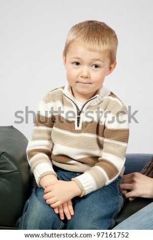 Cute blond boy looking at the camera with a happy smile