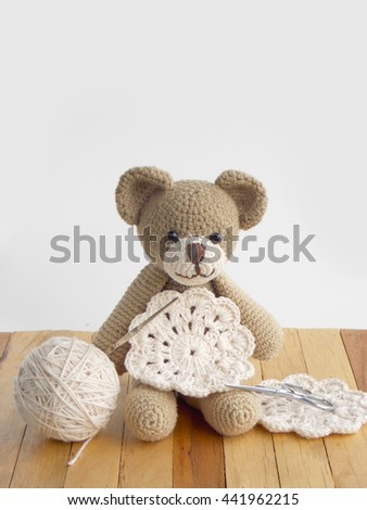 Cute handmade crochet doll and lace