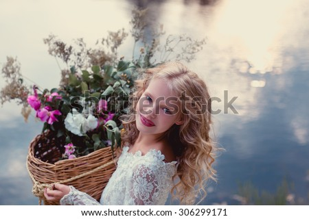 cute little bridesmaid with bunch of flowers wedding concept  cute princess girl Happy little schoolgirl with flowers. Back to school outdoor - stock photo