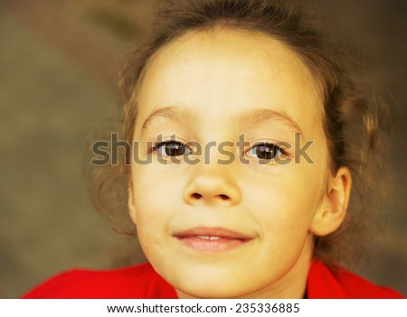 Cute little girl is dreaming - stock photo