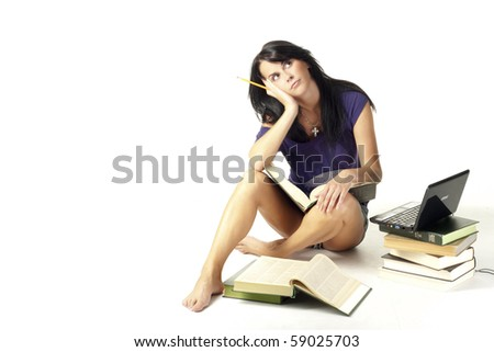 cute student girl do homework with books and laptop over white background - stock photo