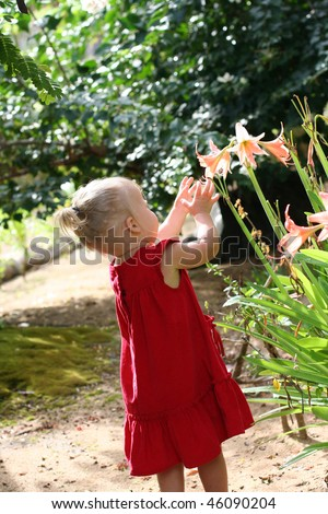 Cute 4 years old girl outdoors at sunny summer day - stock photo