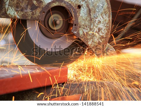 cutting a metal pipe - stock photo