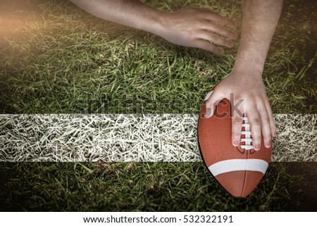 3D American football player scoring a touchdown against grass