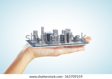 3D city buildings on smartphone and man hand - stock photo