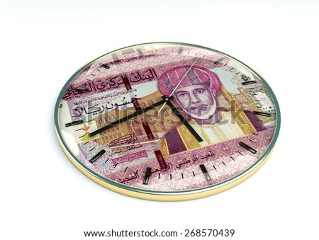 3d clock with Oman currency printer inside it isolated on white background - stock photo