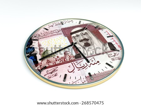 3d clock with Saudi currency printer inside it isolated on white background - stock photo