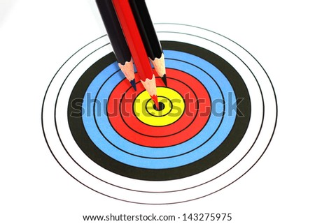 2D dartboard with pencils point to the center on white background