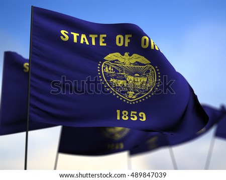 3d flags of Oregon on blue sky background