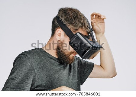 3d glasses, a man plays a virtual reality game on a gray background