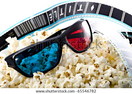 3-D glasses, film strip and popcorn, 3d experience - stock photo