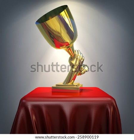 3d gold cup on red silk pedestal - stock photo
