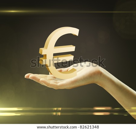 3d Gold Euro Sign on a woman's hand - stock photo