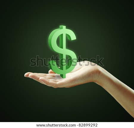 3d Green Dollar Sign on a woman's hand.Isolated on a black background