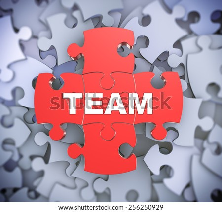 3d illustration of attached jigsaw puzzle pieces word team presentation on background of heap of puzzle pieces - stock photo