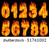 3D Illustration of burning digits isolated on black background. - stock photo