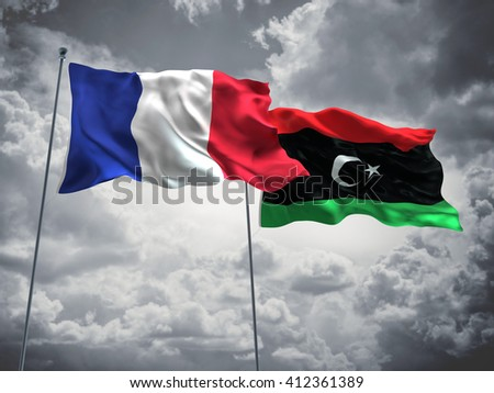 3D illustration of France & Libya Flags are waving in the sky with dark clouds  - stock photo