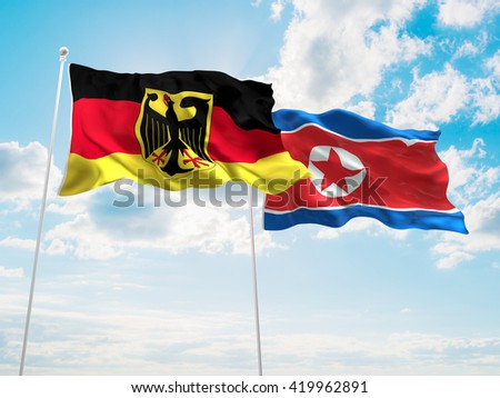 3D illustration of Germany & North Korea Flags are waving in the sky - stock photo